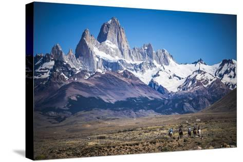 Gauchos Riding Horses and Herding Sheep with Mount Fitz Roy Behind, Patagonia, Argentina-Matthew Williams-Ellis-Stretched Canvas Print
