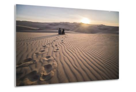 Couple Watching the Sunset over Sand Dunes in the Desert at Huacachina, Ica Region, Peru-Matthew Williams-Ellis-Metal Print