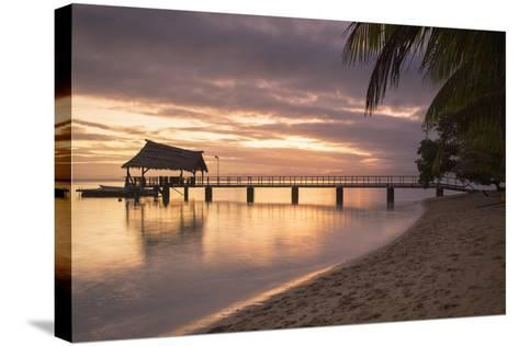 Jetty on Leleuvia Island at Sunset, Lomaiviti Islands, Fiji, South Pacific, Pacific-Ian Trower-Stretched Canvas Print