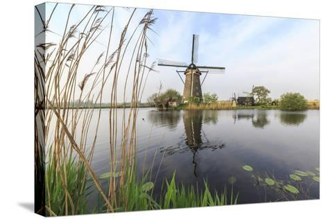 Green Grass Frames the Windmills Reflected in the Canal, Netherlands-Roberto Moiola-Stretched Canvas Print