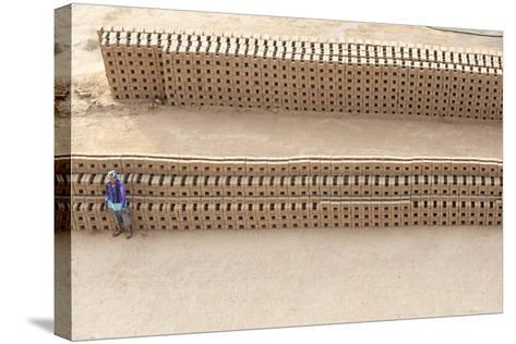Female Brick Worker Standing Beside Hand Made Bricks Stacked to Dry before Baking, Rajasthan, India-Annie Owen-Stretched Canvas Print