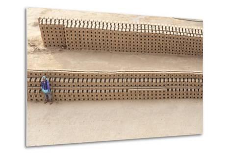 Female Brick Worker Standing Beside Hand Made Bricks Stacked to Dry before Baking, Rajasthan, India-Annie Owen-Metal Print