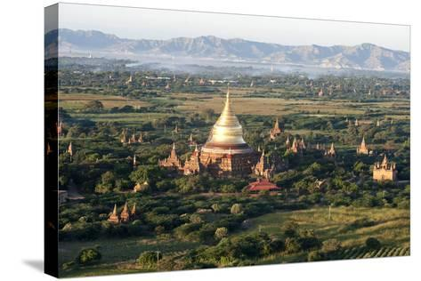The Golden Stupa of Dhammayazika Pagoda Amongst Some Other Terracotta Buddhist Temples in Bagan-Annie Owen-Stretched Canvas Print