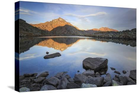 Peak Tambo Reflected in Lake Bergsee at Dawn, Chiavenna Valley, Spluga Valley, Switzerland, Europe-Roberto Moiola-Stretched Canvas Print