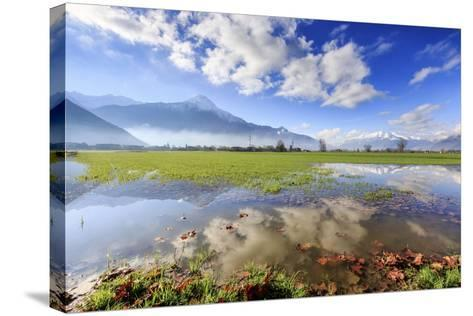 The Natural Reserve of Pian Di Spagna Flooded with Mount Legnone Reflected in the Water, Italy-Roberto Moiola-Stretched Canvas Print