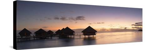 Overwater Bungalows at Le Meridien Tahiti Hotel at Sunset, Pacific-Ian Trower-Stretched Canvas Print