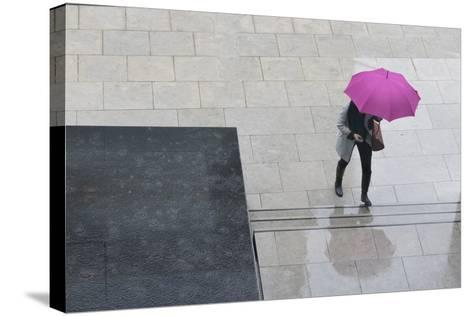 Woman with Umbrella and Mobile Phone Walking Up Steps to Auckland Art Gallery-Nick Servian-Stretched Canvas Print