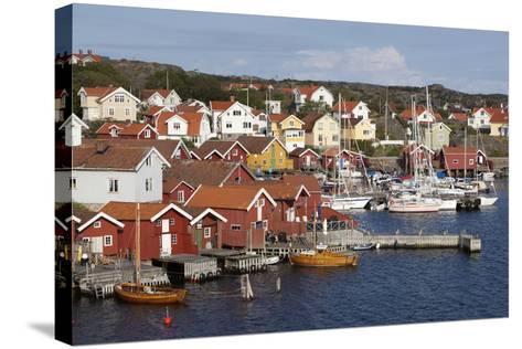 Falu Red Fishermen's Houses in Harbour, Southwest Sweden-Stuart Black-Stretched Canvas Print