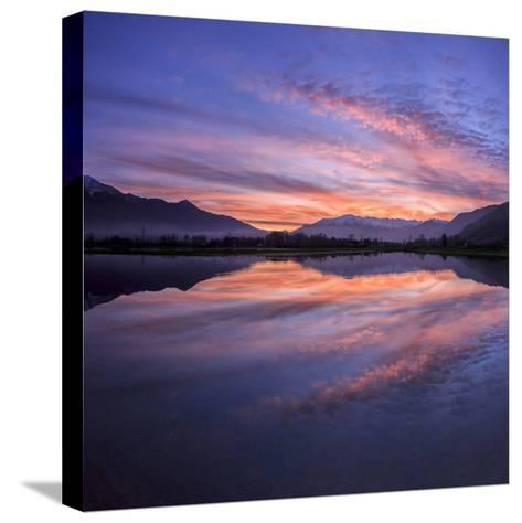 Panoramic View of Pian Di Spagna Flooded with Snowy Peaks Reflected in the Water at Sunset, Italy-Roberto Moiola-Stretched Canvas Print