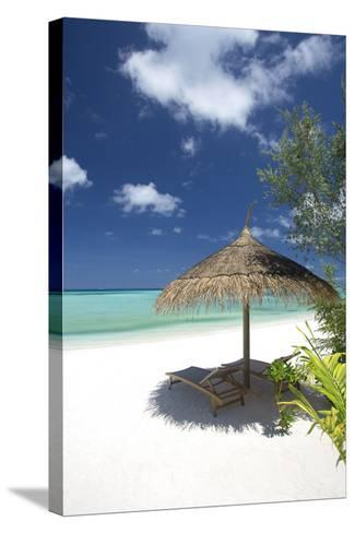 Lounge Chairs under Shade of Umbrella on Tropical Beach, Maldives, Indian Ocean, Asia-Sakis Papadopoulos-Stretched Canvas Print