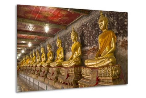 Rows of Gold Buddha Statues, Wat Suthat Temple, Bangkok, Thailand, Southeast Asia, Asia-Stephen Studd-Metal Print