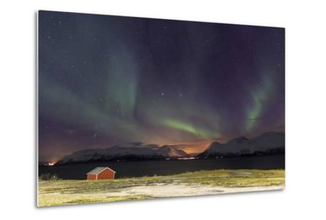 Northern Lights Illuminates the Wooden Cabin at Svensby, Lyngen Alps, Troms, Lapland, Norway-Roberto Moiola-Metal Print