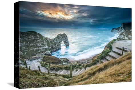 A Winter Sunset at Durdle Door on the Jurassic Coast, Dorset, England, United Kingdom, Europe-John Alexander-Stretched Canvas Print