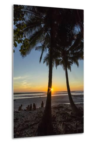 People by Palm Trees at Sunset on Playa Hermosa Beach, Santa Teresa, Costa Rica-Rob Francis-Metal Print