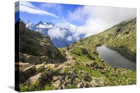 Low Clouds and Mist around Grandes Jorasses While Hikers Proceed on Lac De Cheserys, French Alps-Roberto Moiola-Stretched Canvas Print