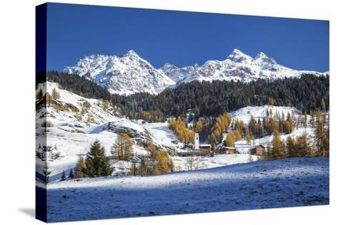 Snowy Landscape and Colorful Trees in the Small Village of Sur, Canton of Graubunden, Switzerland-Roberto Moiola-Stretched Canvas Print