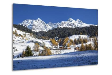 Snowy Landscape and Colorful Trees in the Small Village of Sur, Canton of Graubunden, Switzerland-Roberto Moiola-Metal Print