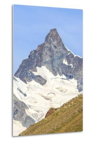 A Paraglider Flies in Front of the Majestic Obergabelhorn, Pennine Alps, Swiss Alps-Roberto Moiola-Metal Print