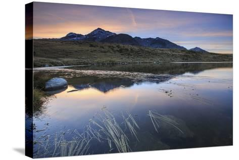 Pink Sky on Peak Emet Reflected in Lake Andossi at Dawn, Italy-Roberto Moiola-Stretched Canvas Print