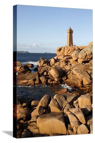 Lighthouse and Pink Rocks at Sunset, Cote De Granit Rose-Stuart Black-Stretched Canvas Print