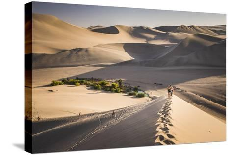 Tourists Climbing Sand Dunes at Sunset at Huacachina, a Village in the Desert, Ica Region, Peru-Matthew Williams-Ellis-Stretched Canvas Print
