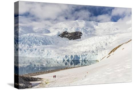 Two Hikers Surrounded by Ice-Capped Mountains and Glaciers in Neko Harbor, Polar Regions-Michael Nolan-Stretched Canvas Print
