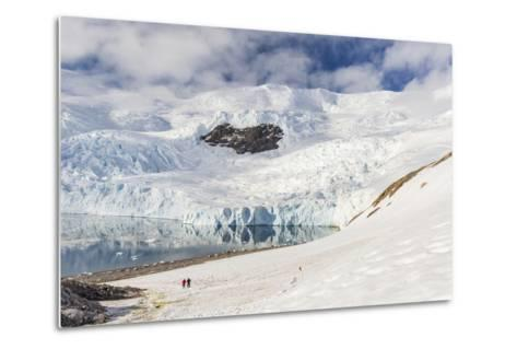 Two Hikers Surrounded by Ice-Capped Mountains and Glaciers in Neko Harbor, Polar Regions-Michael Nolan-Metal Print