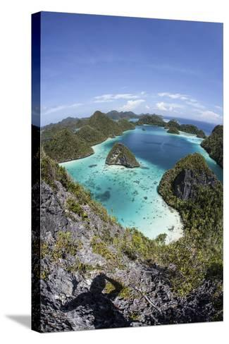 Rugged Limestone Islands Surround a Gorgeous Lagoon in Raja Ampat-Stocktrek Images-Stretched Canvas Print