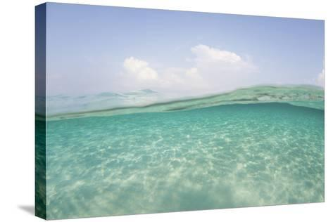 Sunlight Ripples across a Shallow Sand Flat in Indonesia-Stocktrek Images-Stretched Canvas Print