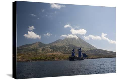 An Indonesian Pinisi Schooner Sails Near a Remote Volcanic Island-Stocktrek Images-Stretched Canvas Print