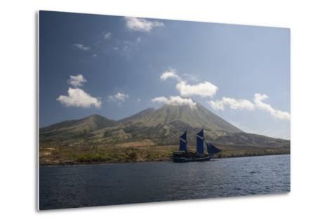 An Indonesian Pinisi Schooner Sails Near a Remote Volcanic Island-Stocktrek Images-Metal Print