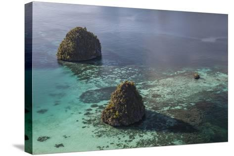 Limestone Islands Surrounded by a Coral Reef in Raja Ampat-Stocktrek Images-Stretched Canvas Print