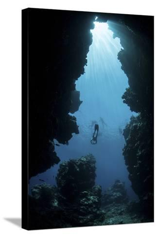 Sunlight Descends Underwater and into a Crevice on Palau's Barrier Reef-Stocktrek Images-Stretched Canvas Print