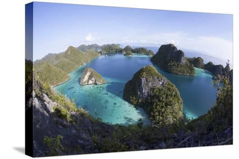 Limestone Islands Surround a Lagoon in a Remote Part of Raja Ampat-Stocktrek Images-Stretched Canvas Print