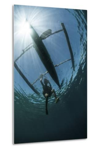 A Fisherman Uses a Wooden Outrigger Near a Remote Island in Indonesia-Stocktrek Images-Metal Print