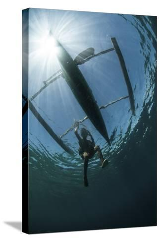 A Fisherman Uses a Wooden Outrigger Near a Remote Island in Indonesia-Stocktrek Images-Stretched Canvas Print