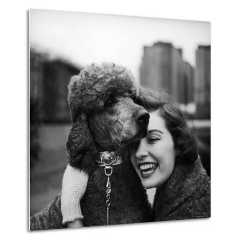 Woman Profiling a Big Smile While Adoring Her Poodle Wearing Large Swiss Watch on Dog Collar-Yale Joel-Metal Print
