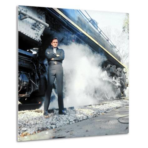Country Music Star Johnny Cash Wearing Black Clothing and Standing in Front of a Locomotive-Michael Rougier-Metal Print