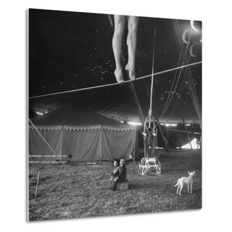 Two Small Children Watching Circus Performer Practicing on Tightrope, Her Legs Only Visible-Nina Leen-Metal Print