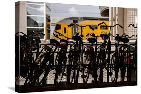 Bicycles at Centraal Station-Erin Berzel-Stretched Canvas Print