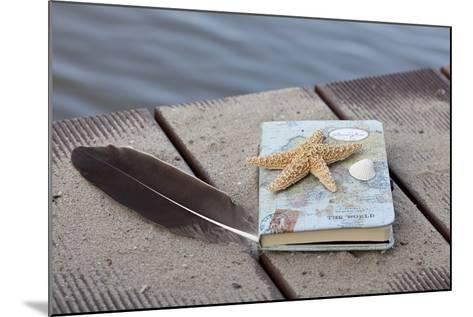 Still Life with Travel Diary, Foodbridge, Mussel, Feather, Starfish-Andrea Haase-Mounted Photographic Print