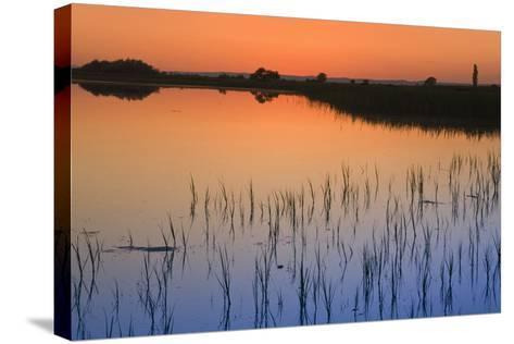 Austria, Burgenland, Ferto National Park, Lake Neusiedl, Scenic View of Lake at Sunset-Rainer Mirau-Stretched Canvas Print