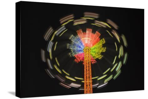 Germany, Bavaria, Munich, Theresienwiese Oktoberfest, Star Flyer Carousel, Night-Udo Siebig-Stretched Canvas Print