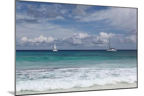 The Seychelles, La Digue, Anse Coco, Two Catamaran Yachtsmen-Catharina Lux-Mounted Photographic Print