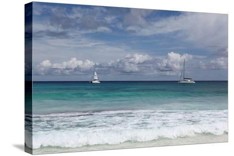 The Seychelles, La Digue, Anse Coco, Two Catamaran Yachtsmen-Catharina Lux-Stretched Canvas Print