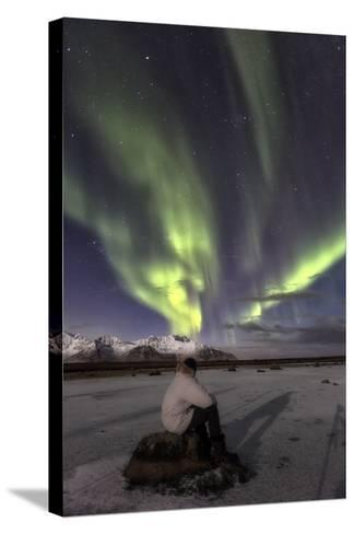 Man Sitting on Rock and Watching the Polar Light, at Night-Dieter Meyrl-Stretched Canvas Print