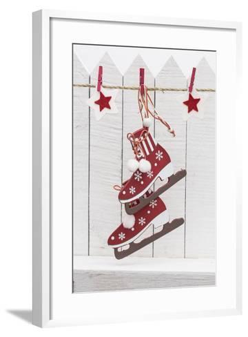 Christmas Ornament Hanging in Front of White Wooden Fence-Andrea Haase-Framed Art Print