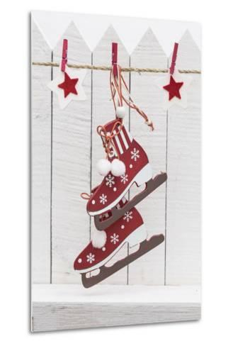 Christmas Ornament Hanging in Front of White Wooden Fence-Andrea Haase-Metal Print