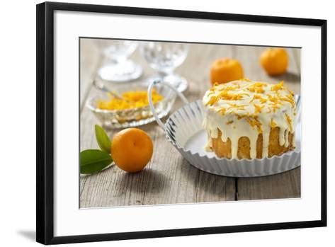 Small Orange Cake with White Icing on Wooden Table-Jana Ihle-Framed Art Print