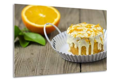 Small Orange Cake with White Icing on Wooden Table-Jana Ihle-Metal Print